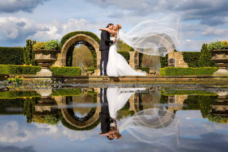 Husband and wife with sweeping veil image
