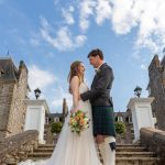 Bride and groom on the steps of atholl palace hotel