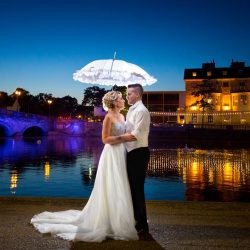 bride-and-groom-by-river-ouse-at-night-under-umbrella