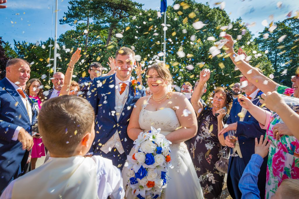 wedding-guests-throwing-confetti-at-bride-and-groom
