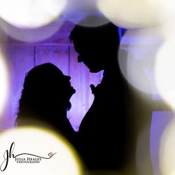 wedding couple against purple silhouette