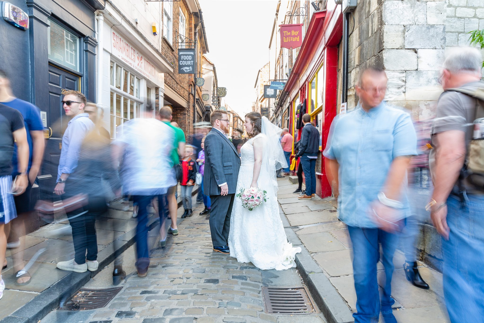 bride-and-groom-on-york-shambles-with-blurred-general-public