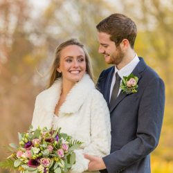bride-and-groom-standing-together-holding-bouquet