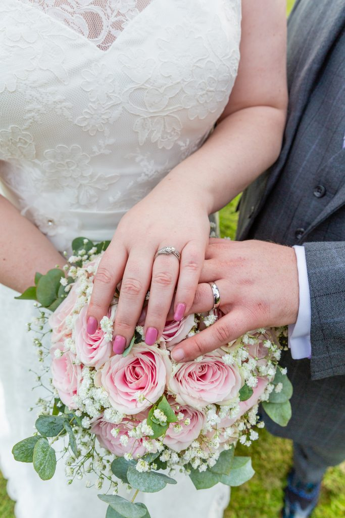 wedding-rings-on-top-of-bouquet Mercure Fairfield manor york wedding photography