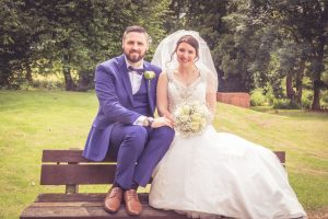 bride-and-groom-sat-on-bench-mercure-fairfield-manor-york