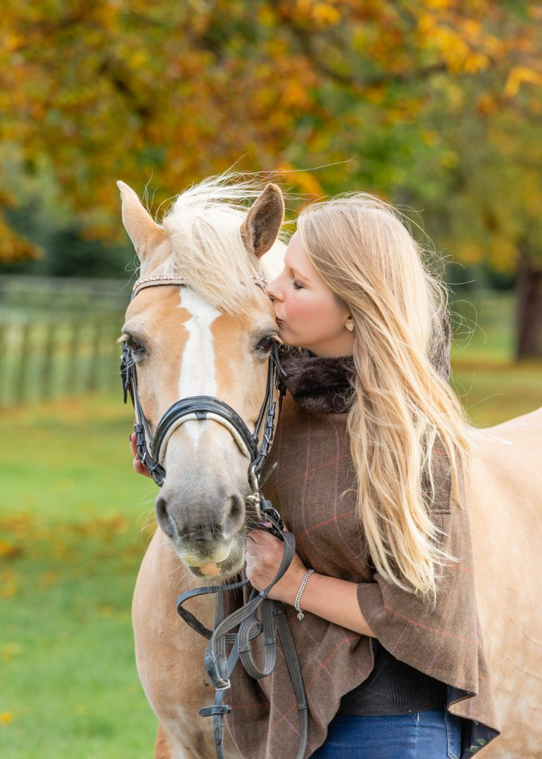 horses-owner-kissing-horses-head-with-trees-in-background