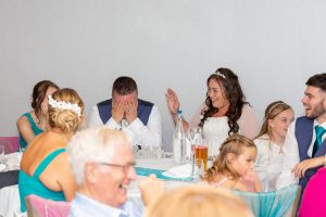 wedding photography at kp club Groom looking embarrassed during the best man speech