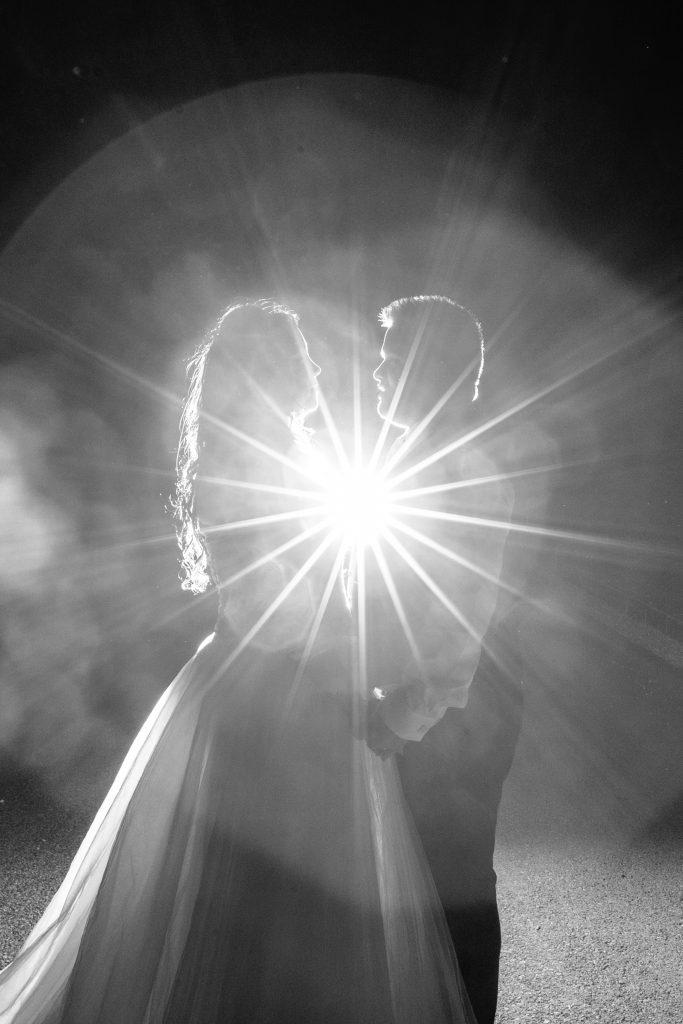 KP Club Pocklington York black-and-white-bride-and-groom-with-starburst-flash-behind