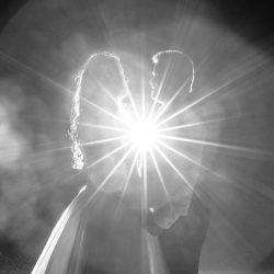 black-and-white-bride-and-groom-with-starburst-flash-behind