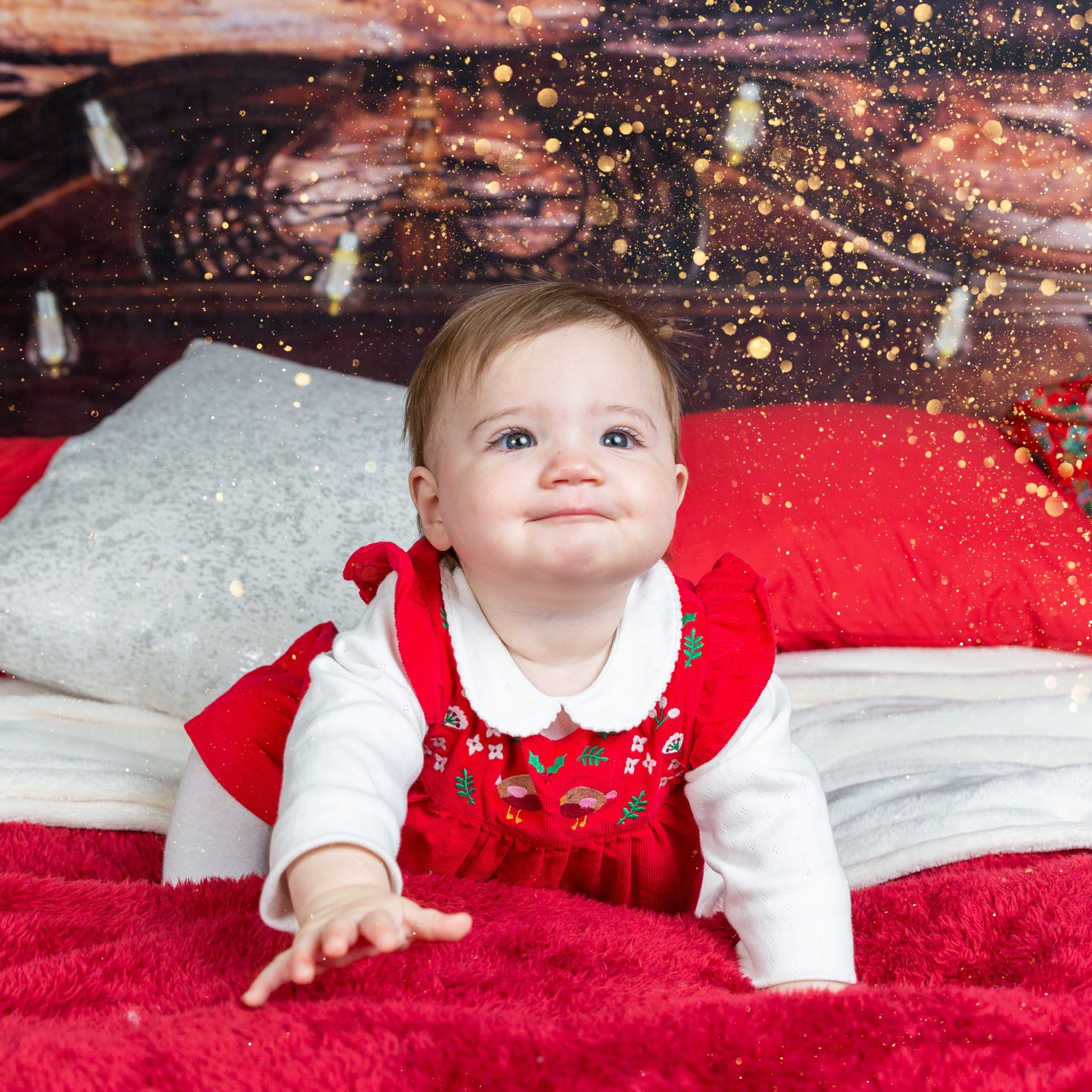 baby girl on christmas bed
