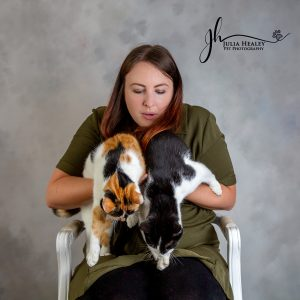 lady with 2 cats on her lap