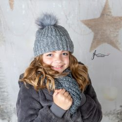 girl wearing grey with Christmas backdrop